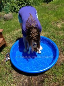 Alex trying to coax Louis into the kiddie pool!